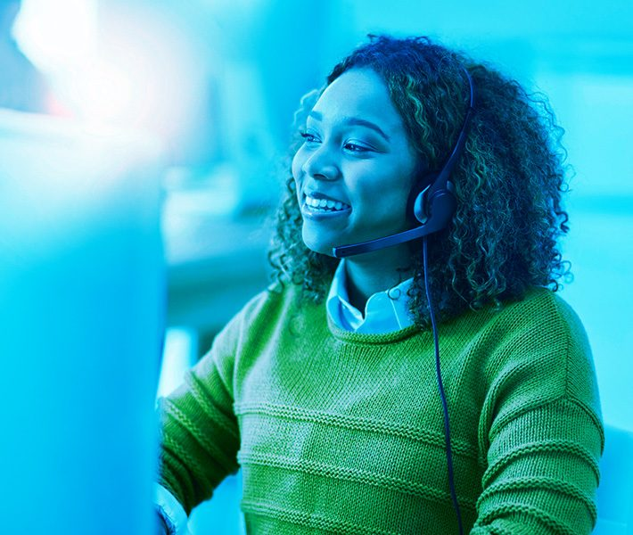 a young woman working with a headset on